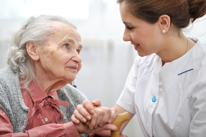 Senior woman with her hospice caregiver at home